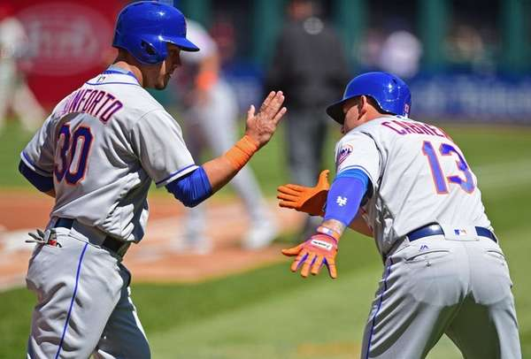 New York Mets' Michael Conforto is congratulated