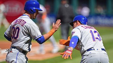 New York Mets' Michael Conforto is congratulated