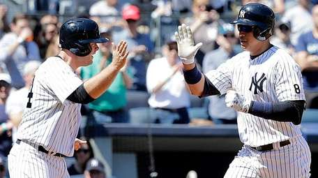 New York Yankees' Brian McCann waits at home