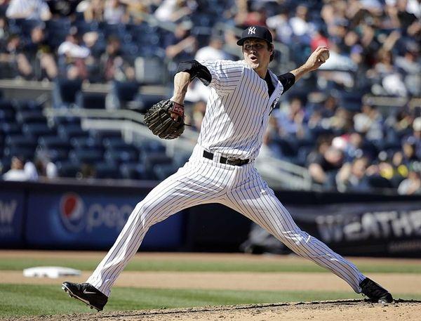 New York Yankees relief pitcher Andrew Miller struck