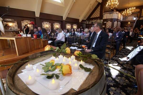 Attendees listen Sunday, April, 17, 2016, as names