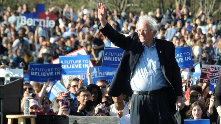 Democratic presidential candidate Bernie Sanders waves to supporters