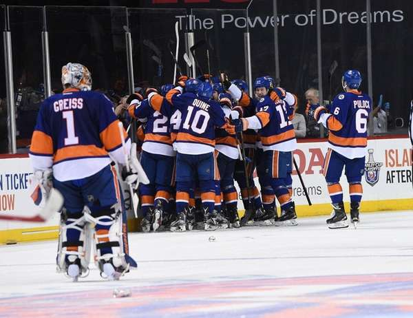 New York Islanders players celebrate a goal