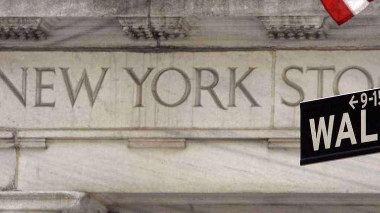 A Wall Street sign at an entrance to