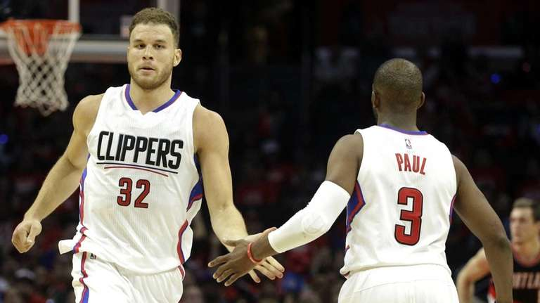 Blake Griffin celebrates a made three with teammate