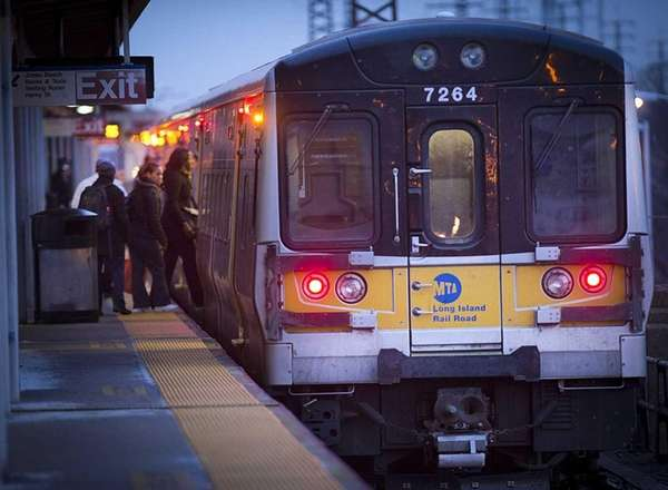 Morning commuters board a westbound Long Island Rail