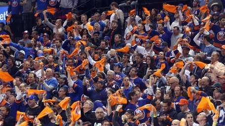 The New York Islanders fans celebrate a second