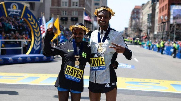 Runners Atsede Baysa, the women's winner, and men's
