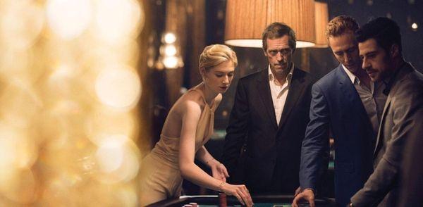 Elizabeth Debicki, Hugh Laurie and Tom Hiddleston in