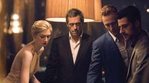 Elizabeth Debicki, Hugh Laurie and Tom Hiddleston in
