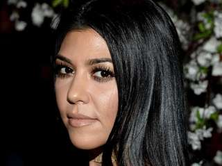 TV personality Kourtney Kardashian attends the alice +