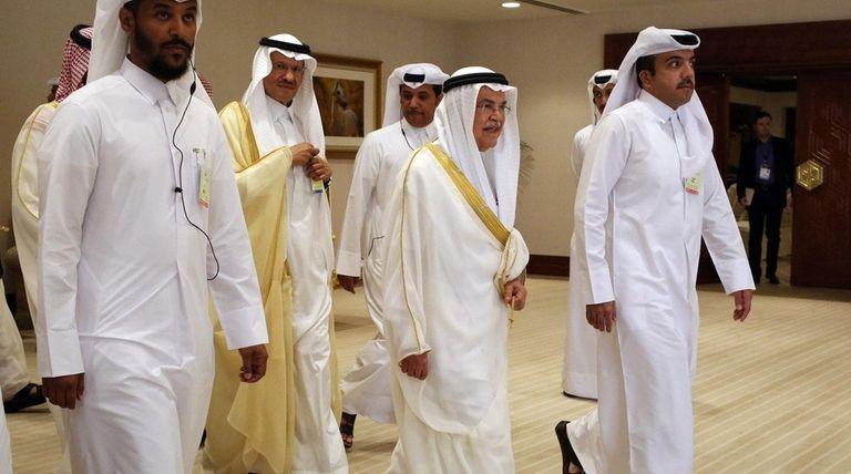 Saudi oil minister Ali al-Naimi, center right, arrives