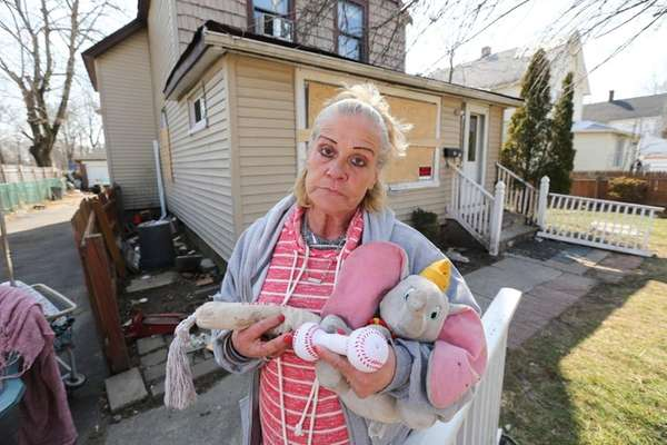 Colleen Kester holds toys that belonged to her
