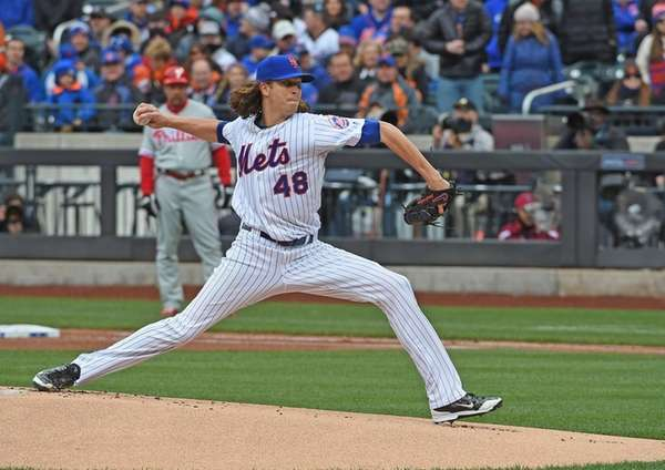 Jacob deGrom pitches against the Phillies during