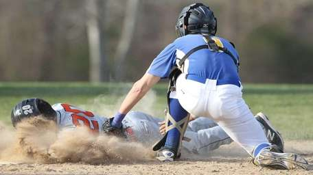 Babylon's Brandon Beierle (20) gets tagged out at