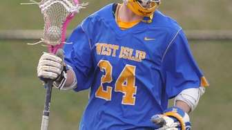Conor Smith of West Islip circles behind the