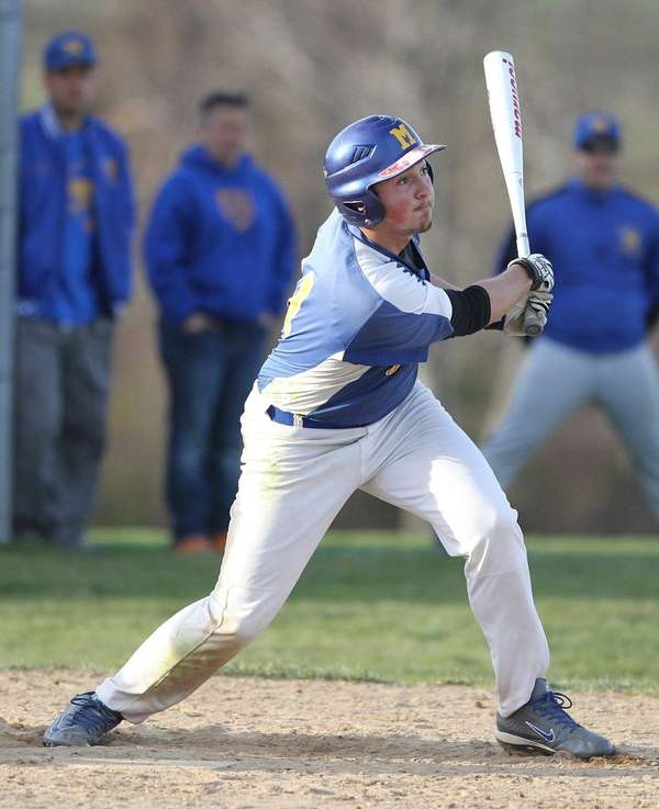 Mattituck's Victor Proferes launches a sacrifice fly to