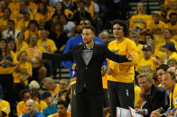 Injured point guard Stephen Curry of the Golden