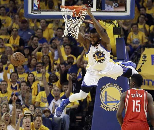Golden State Warriors' Festus Ezeli scores over Houston