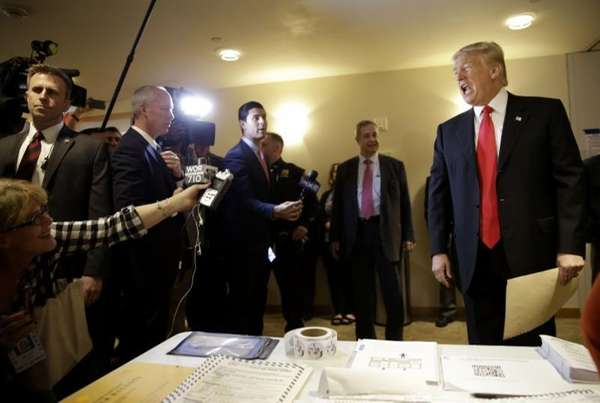Republican presidential candidate Donald Trump talks to reporters