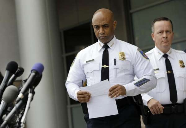 Baltimore Police Department Commissioner Anthony Batts, center, approaches