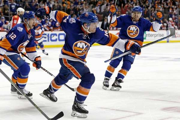 Islanders defenseman Thomas Hickey (14) celebrates his