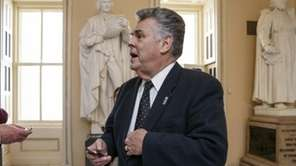 Rep. Peter King stands outside the House chamber