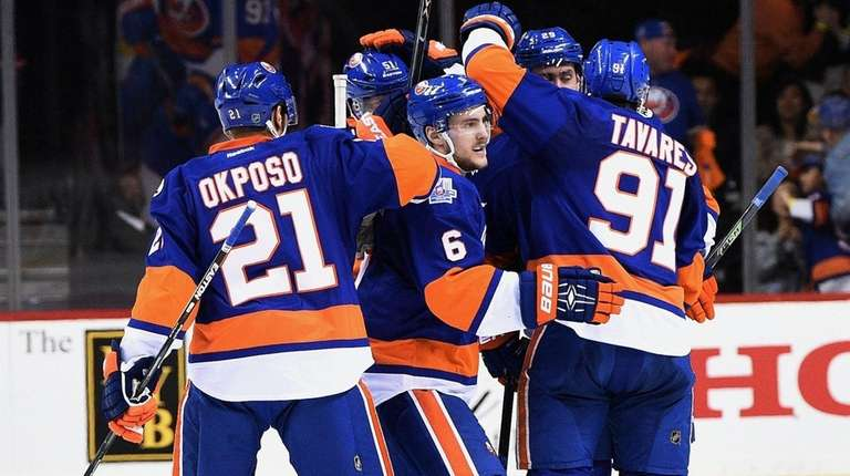 New York Islanders players celebrate a power