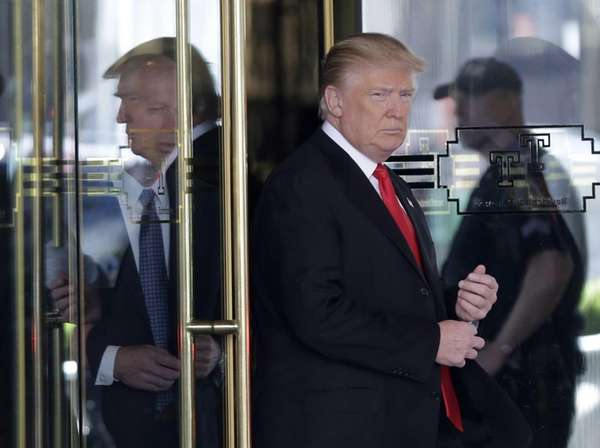 Republican presidential candidate Donald Trump leaves his apartment