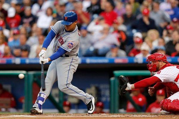 New York Mets' Michael Conforto, left, hits a