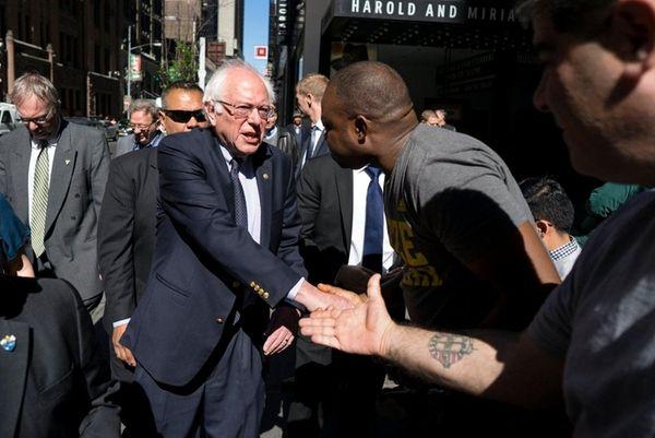 Democratic presidential candidate Bernie Sanders, greeting people near