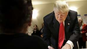 Republican presidential candidate Donald Trump fills out paperwork