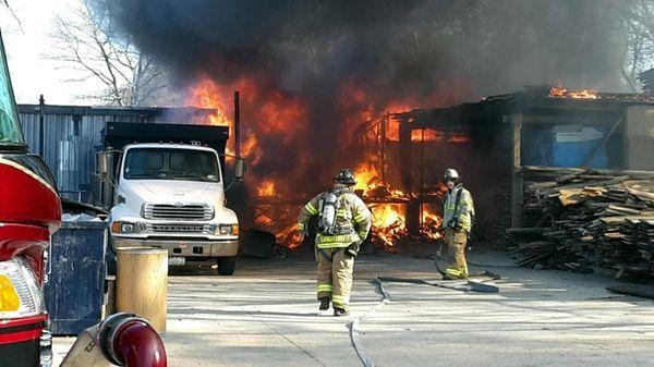 Firefighters battle a blaze on Wednesday morning, April