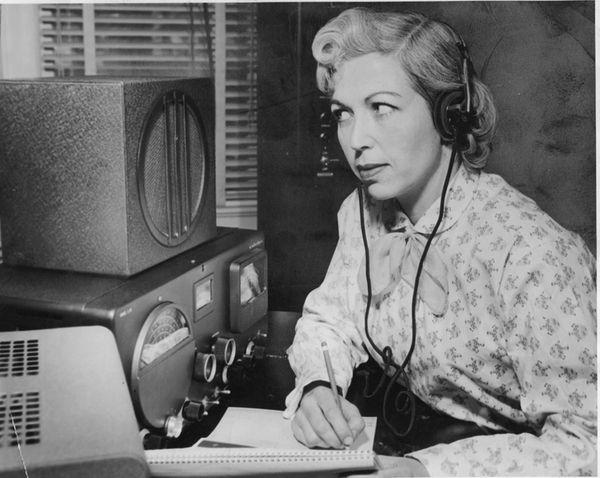 Mrs. Dorothy Strauber of Lynbrook uses earphones to