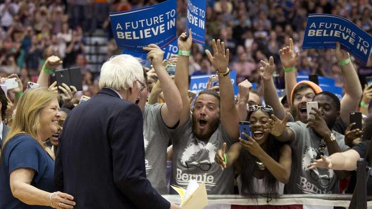 Supporters cheer as Democratic presidential candidate Sen. Bernie