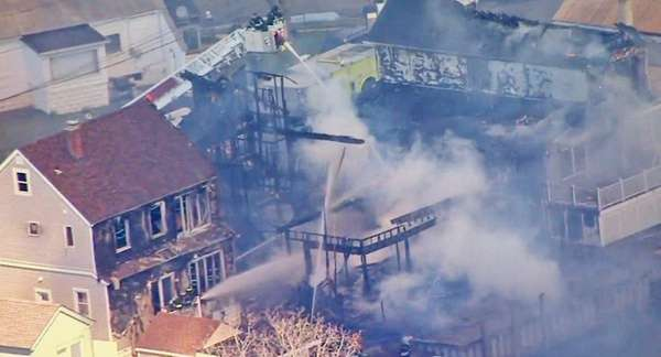 Firefighters battled a fire that spread to five