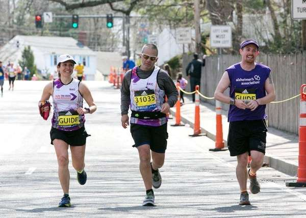 Philip Posa, 45, of Westhampton, (center) running in