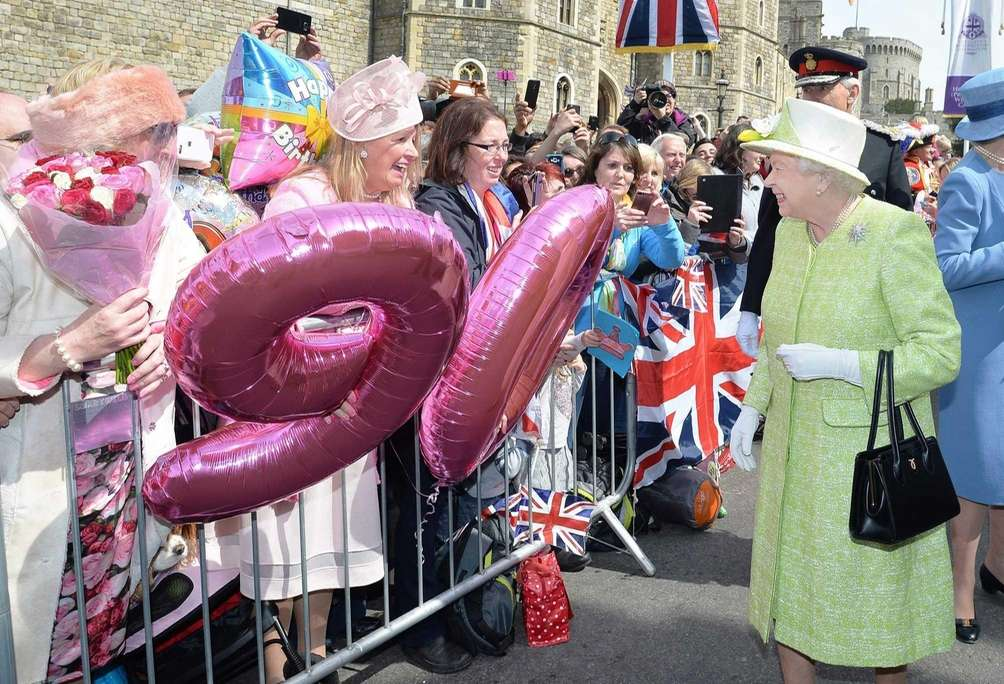 Britain's Queen Elizabeth II greets well-wishers during a