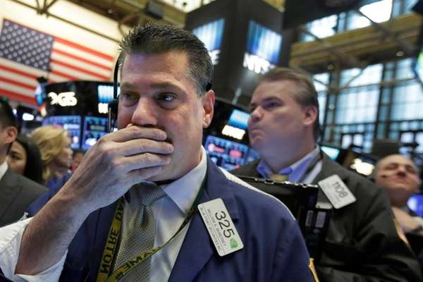 Trader William McInerney reacts Wednesday, April 20, 2016,