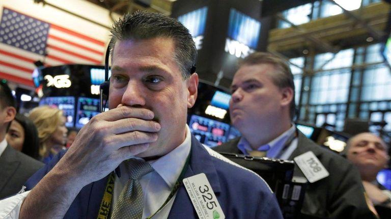Trader William McInerney reacts Wednesday, April 20, 2016,