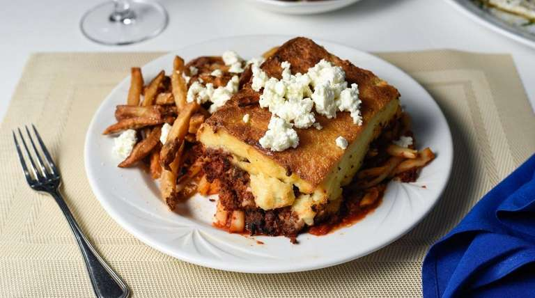 Moussaka, made with zucchini, eggplant, and ground beef,