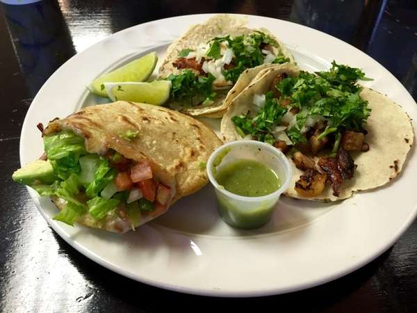Specialties at Nelly's Taqueria in Hicksville include, clockwise
