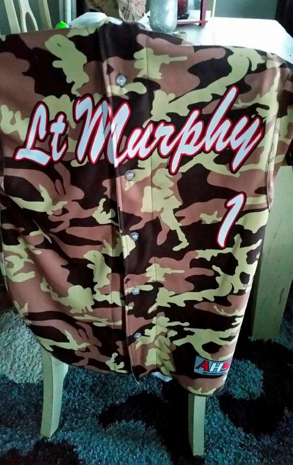 Patchogue-Medford alternate jersey honoring Lt. Michael P. Murphy
