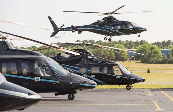 A helicopter arrives at East Hampton Town Airport
