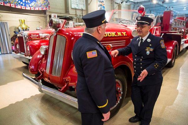 Michael Reid, of the Merrick Fire Department, left,