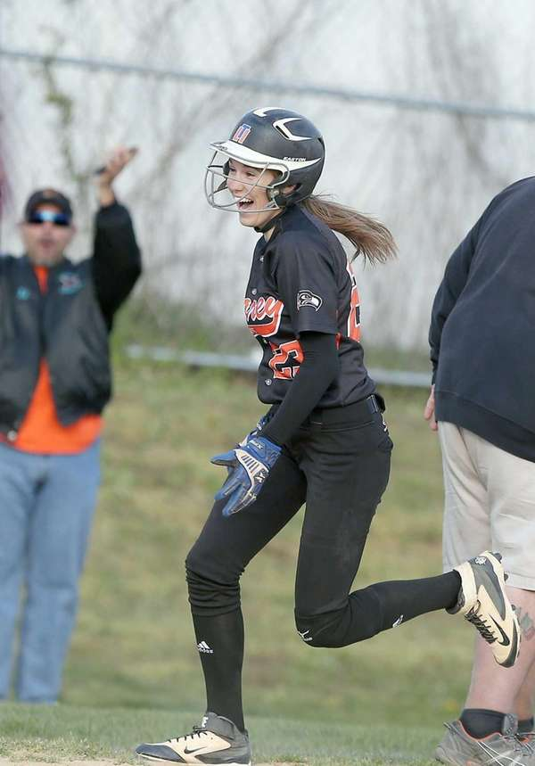 Carey's Amanda Ulzheimer rounds third after hitting a