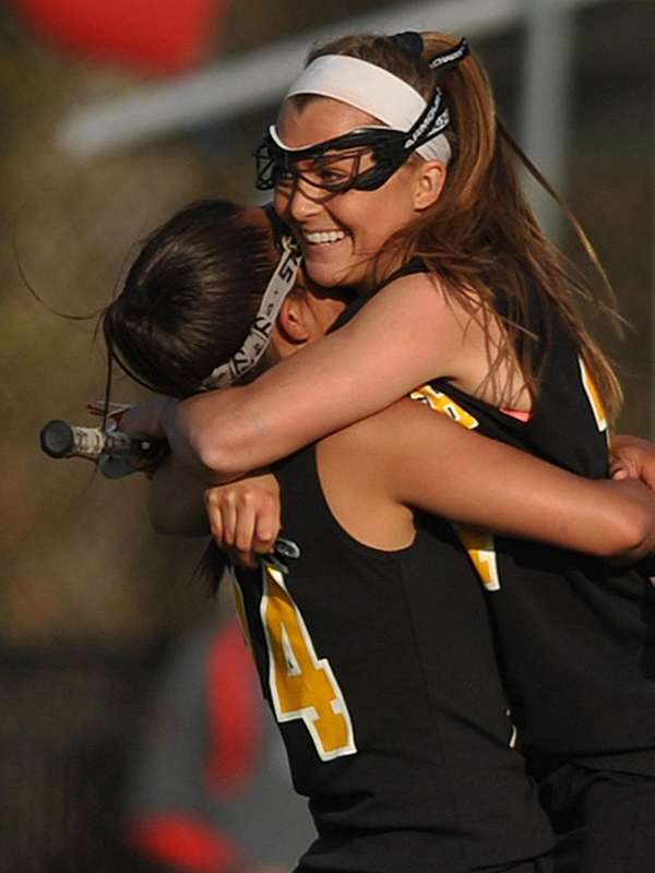 Wantagh's Taylor Rossi, left, hugs Nikki Sliwak, who