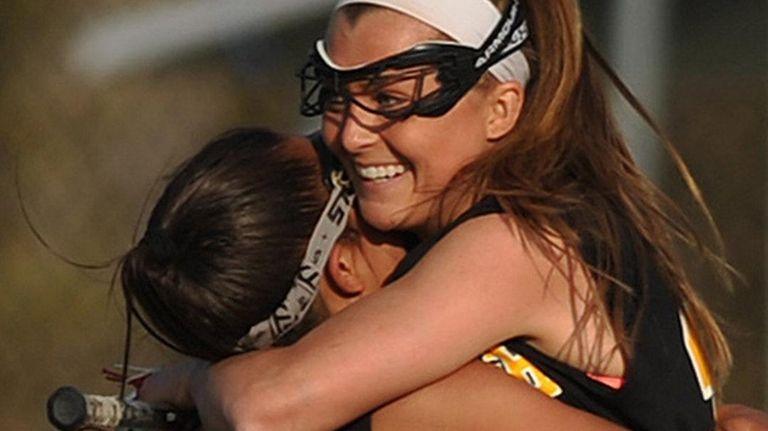 Wantagh's Taylor Rossi, left, hugs Nikki Sliwak, who