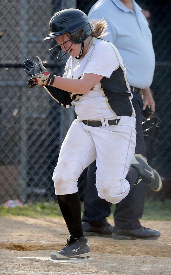 Sachem North's Liz D'Agostino celebrates as she scores