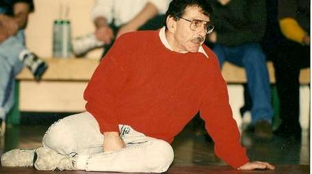 Former longtime Amityville wrestling coach Norm Maisel is